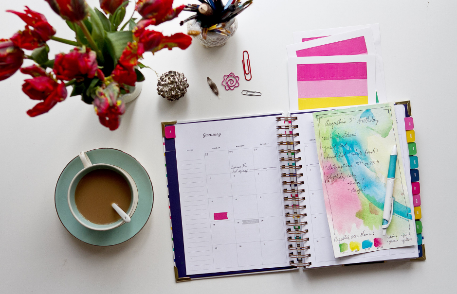 image of a desk with flowers, a planner, and a cup of coffee | Funeral Pre-Planning Guide | Overnight Caskets