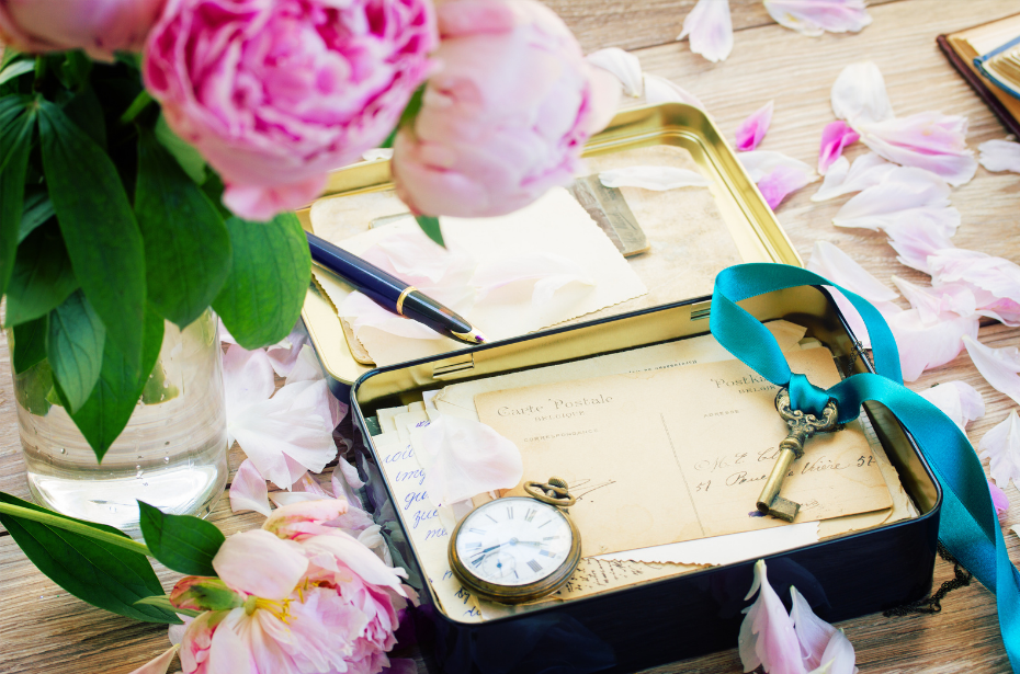 image of a memory box with letters flowers, a key, and a watch | Pre-Purchase a Casket | Overnight Caskets