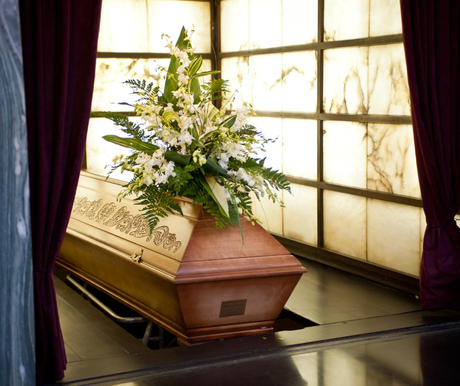 photo of a casket with flowers on top | safely buy a casket online | Overnight Caskets