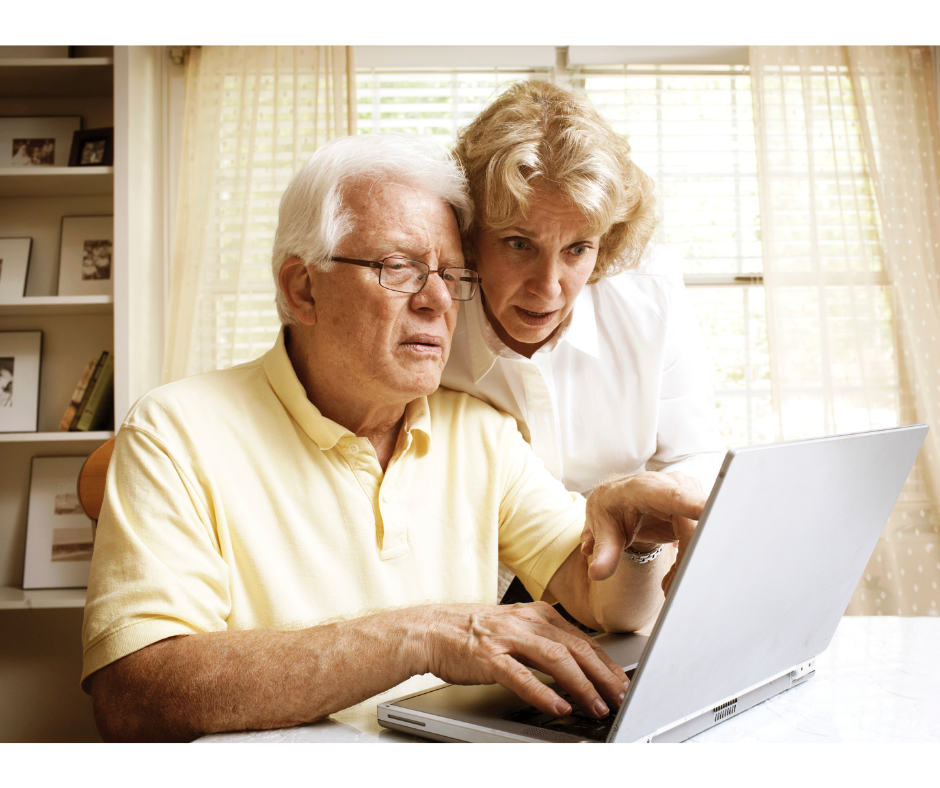 two old people looking at a computer | safely buy a casket online | Overnight Caskets
